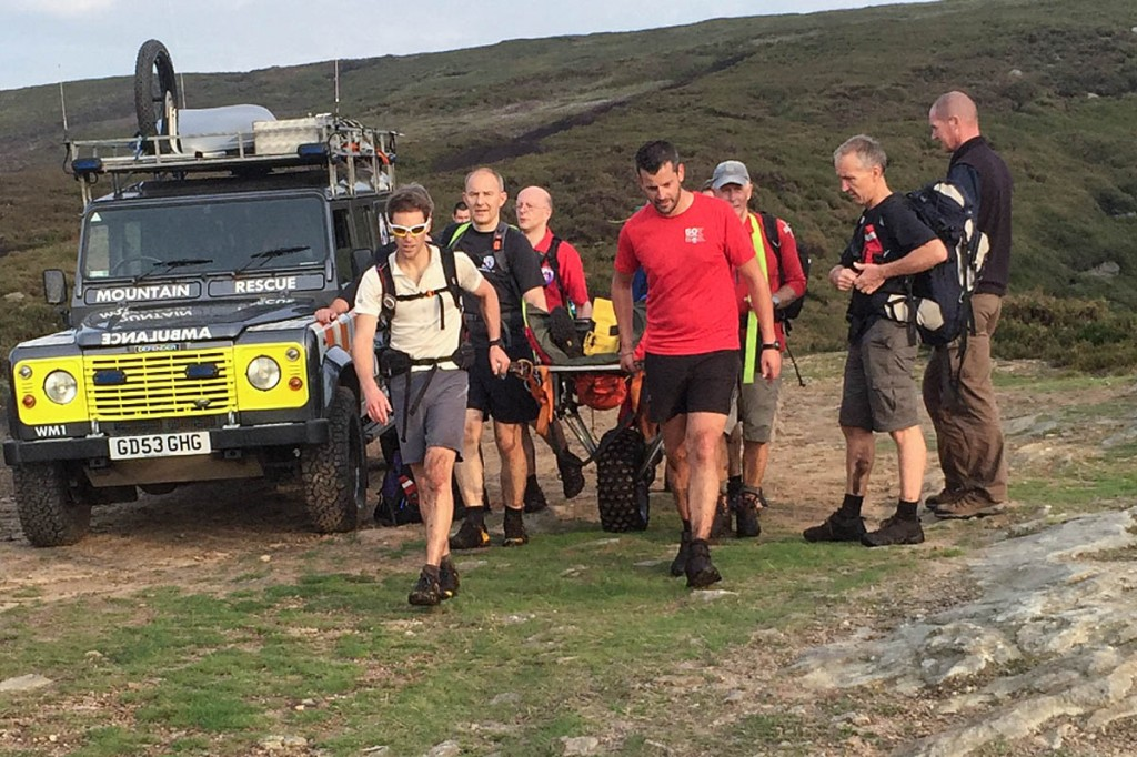 The walker is stretchered from the hill. Photo: Glossop MRT