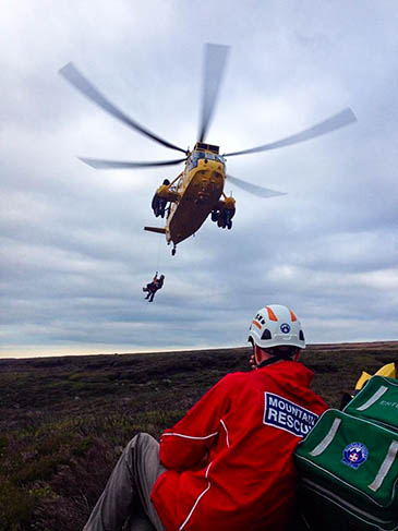 The RAF Sea King in action at the rescue site on Bleaklow. Photo: Glossop MRT
