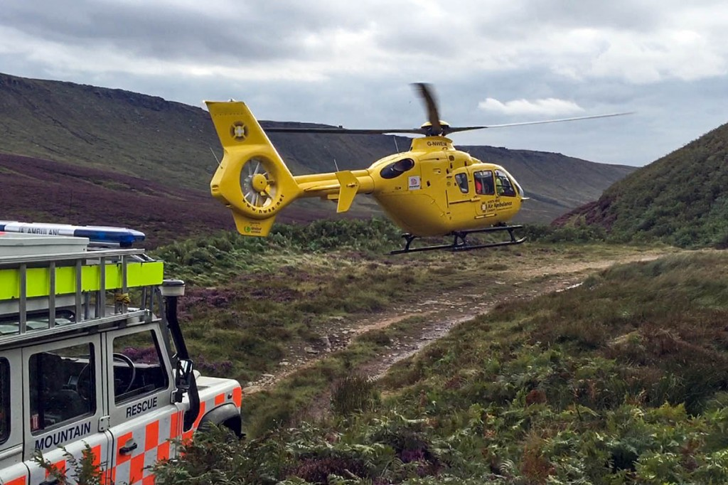 The air ambulance takes off from the hillside. Photo: Glossop MRT