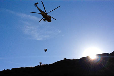 The injured woman is winched into the Sea King from Fairbrook. Photo: Glossop MRT