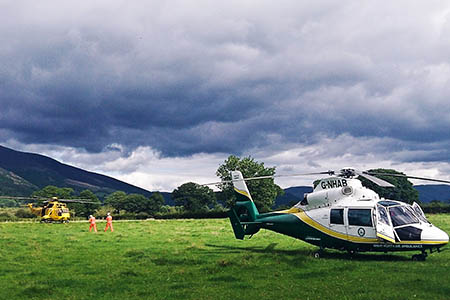The Great North Air Ambulance and an RAF Sea King at the incident in which a woman was injured on Barf. Photo: GNAA
