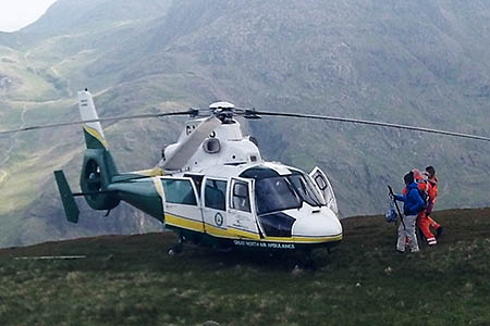 The helicopter crew in action on Great Gable. Photo: GNAAS