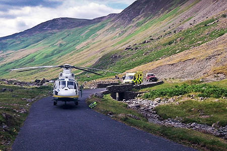 The Great North Air Ambulance at the scene of the incident involving a mountain biker on the Honister Pass. Photo: GNAA
