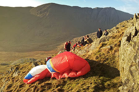 Rescuers at the site on the Old Man of Coniston where the paraglider was injured in a crash. Photo: GNAA