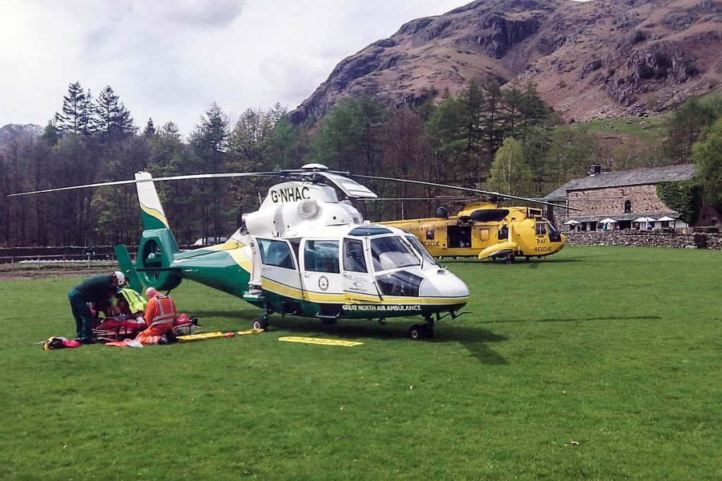 The air ambulance and RAF Sea King at the scene in Great Langdale. Photo: GNAAS