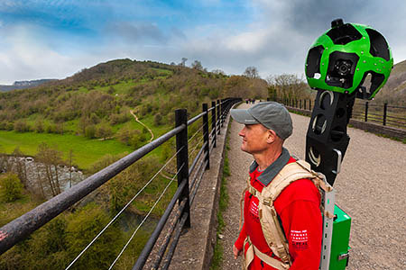 A Peak District national park ranger with Google Trekker backpack on the Monsal Viaduct.