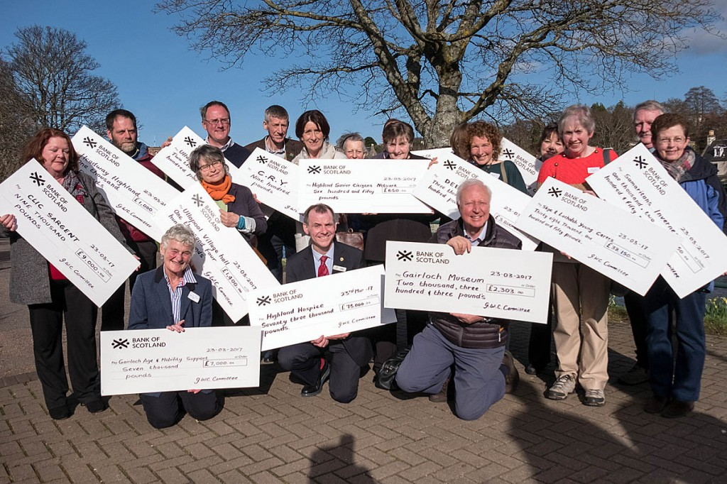 Recipients of the Great Wilderness Challenge funds show off their cheques. Photo: Gary Williamson