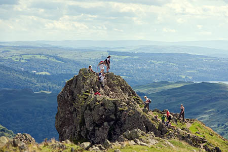 Visitors in the Lake District, one of the parks facing cuts of 28 per cent