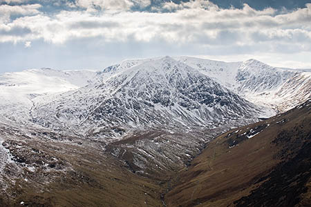 The job entails the ascent in winter of Helvellyn, seen here with Catstye Cam