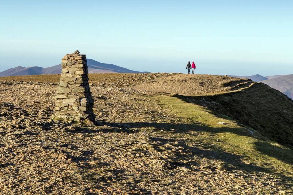 Walkers enjoy winter sunshine on the summit of Helvellyn