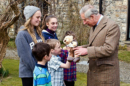 The prince talks to young visitors at Thorns Hall. Photo: Graham Edwards