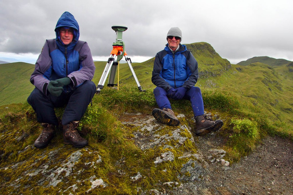 Graham Jackson and John Barnard beside the Leica GS15 at the summit of Creag na Caillich which until their survey was classified as a munro top. Photo: Myrddyn Phillips