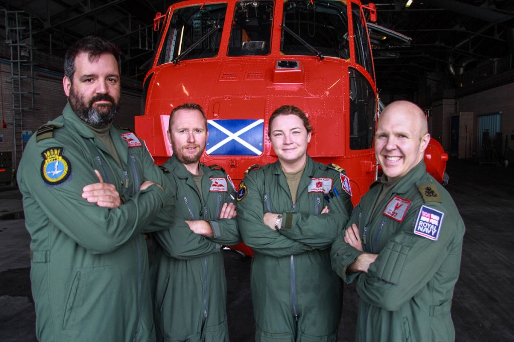 From left: Lieutenant Commander Charles Fuller, Lieutenant Merion Hammond, Lieutenant Angela Lewis and Petty Officer Aircrewman Mike Henson pose with their Sea King. Photo: Crown Copyright