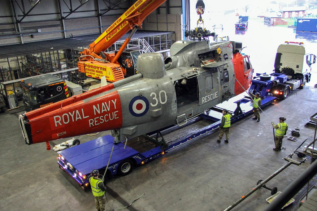 The Sea King is craned on to the low loader before its final journey. Photo: Royal Navy