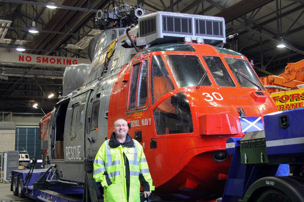 Hugh Shand seen in front of Sea King 30. Photo: Royal Navy