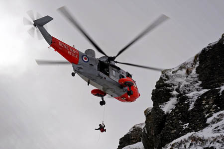 The Royal Navy Sea King winched the couple from the mountainside
