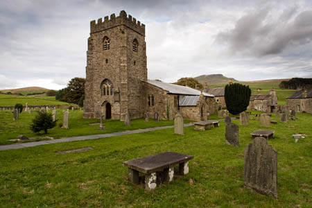 The woman is buried in the graveyard of St Oswald's Church, in the shadow of Pen-y-ghent