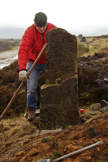 National park ranger Tom Lewis secures the centuries-old milestone back on its base after nearly 70 years