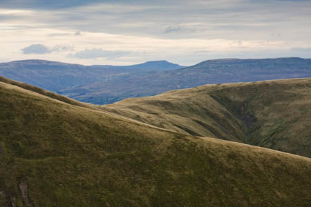 The Howgill fells with Ingleborough and the fells of the Yorkshire Dales in the distance