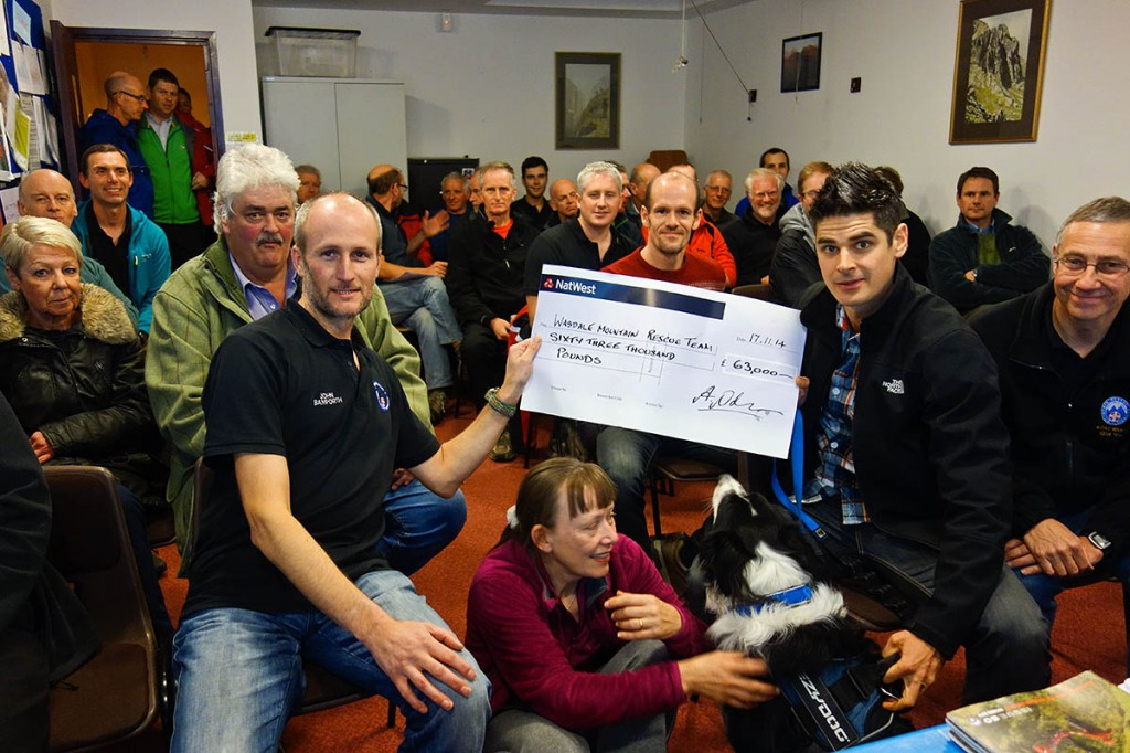 Adam Nolan and Jasper hand over the cheque to Wasdale MRT