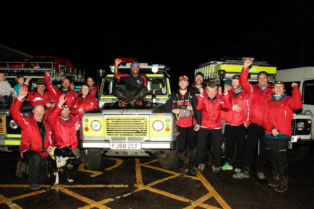 Javed Bhatti celebrates with mountain rescue team members after finishing at Edale. Photo: John Bamber