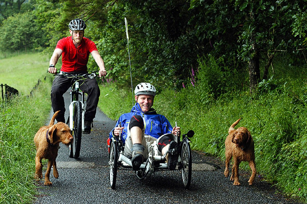 Joe Beaumont, right, and his brother John, accompanied by their dogs during their coast-to-coast ride. Photo: Glen Gater