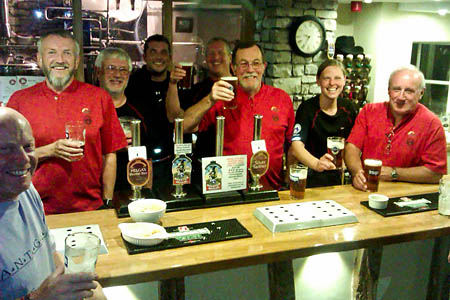 Kendal Mountain Rescue Team members raise a glass to the Mountain Medicine special brew