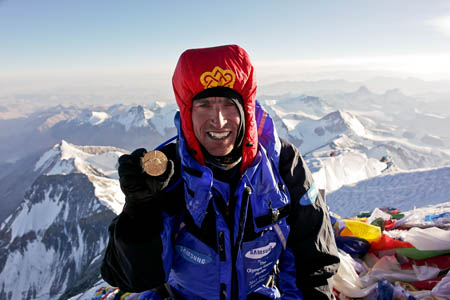 Kenton Cool on Everest's summit last year with the Olympic medal
