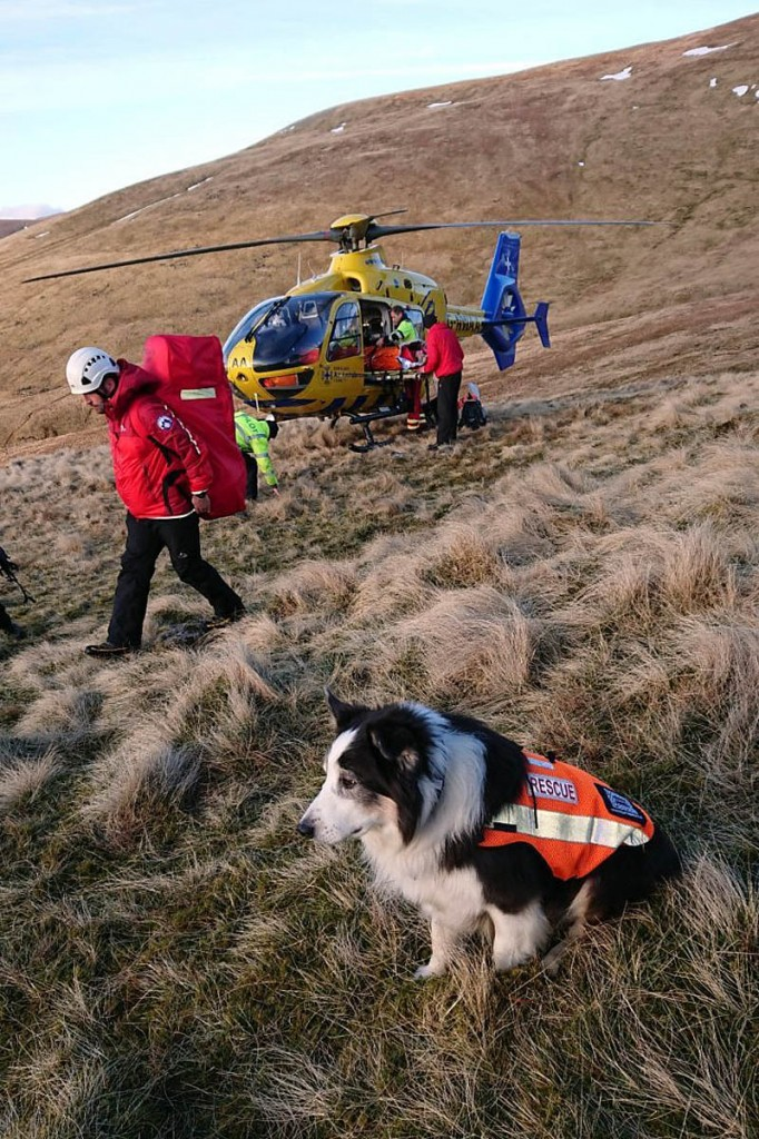 Rescuers at the site with the air ambulance. Photo: Keswick MRT