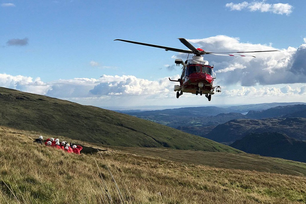 The Coastguard helicopter with rescue team members at the site. Photo: Keswick MRT