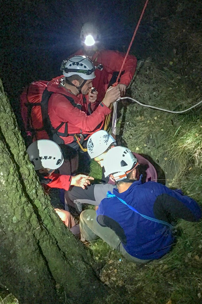 Team members take care of the injured climber at the foot of the crag. Photo: Keswick MRT