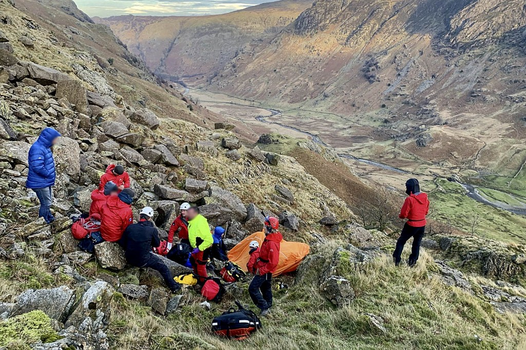 Rescuers with the casualty and the group in Langstrath. Photo: Keswick MRT
