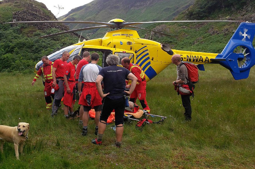 The air ambulance and team members at the Castle Crag incident. Photo: Keswick MRT