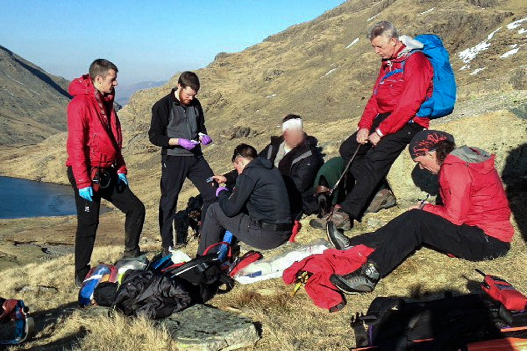 Rescuers with the injured walker. Photo: Keswick MRT