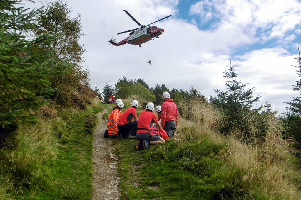 Rescuers and the Coastguard helicopter at the scene on Dodd. Photo: Keswick MRT