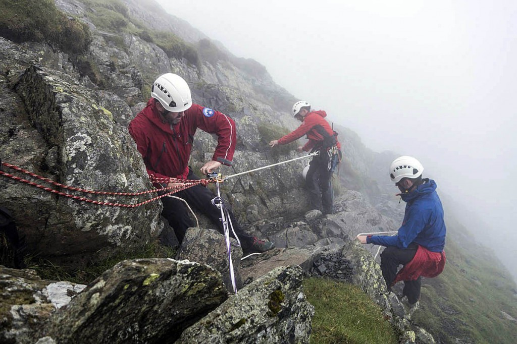 Team members rig up a rope sytem during the Foule Crag rescue. Photo: Keswick MRT