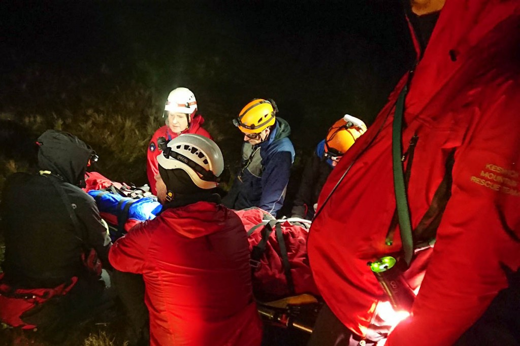 Rescuers stretchered the injured man from the fell. Photo: Keswick MRT