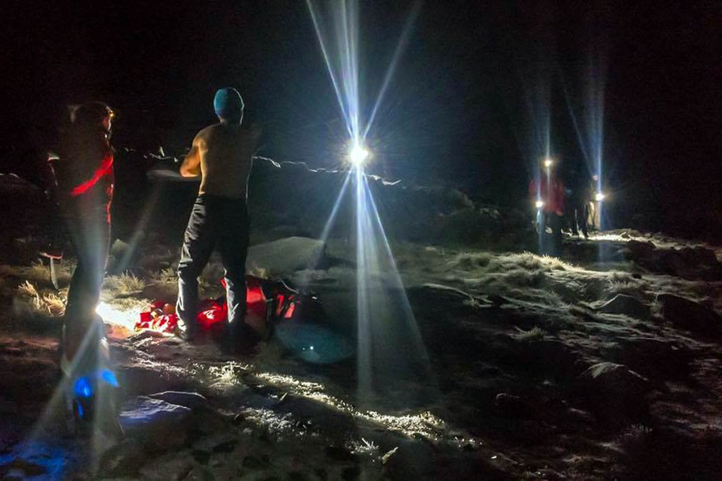 Rescuers bring stranded walkers to safety. Photo: Keswick MRT