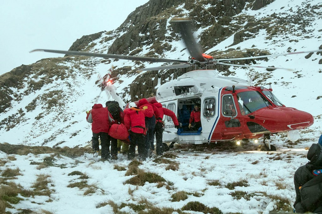 Team members carry the casualty to the helicopter. Photo: Keswick MRT