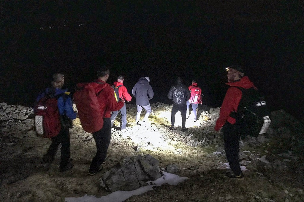 Rescuers lead the lost walkers to safety. Photo: Keswick MRT