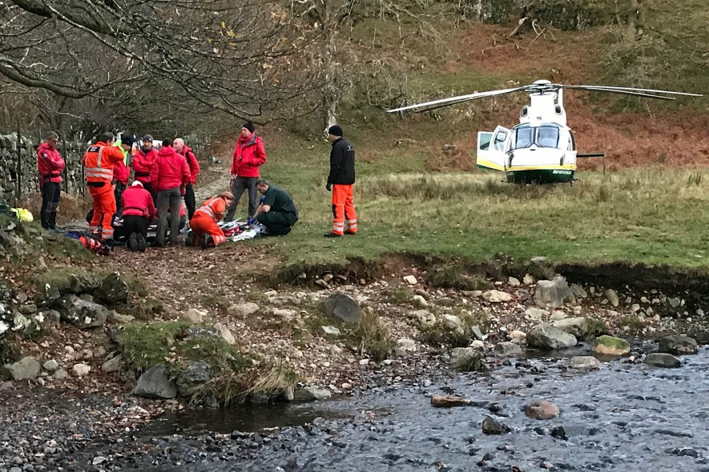 Rescuers and the Great North Air Ambulance at the scene. Photo: Keswick MRT