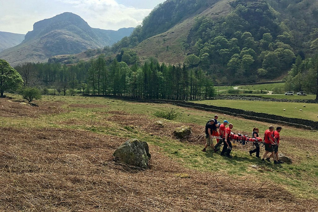 Team members stretcher the injured walker at Lingy End near Stonethwaite. Photo: Keswick MRT