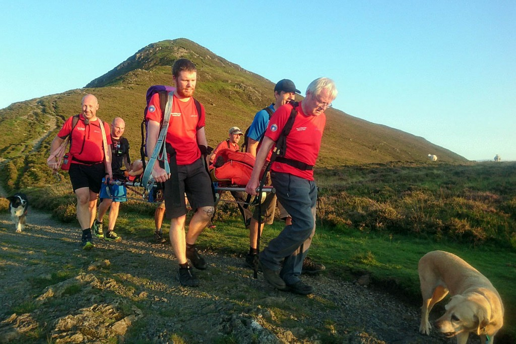 Rescuers stretcher the injured woman from Ullock Pike. Photo: Keswick MRT