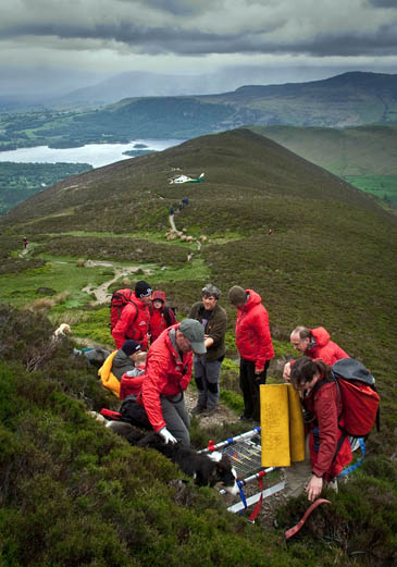 Team members treat the walker. Photo: Keswick MRT