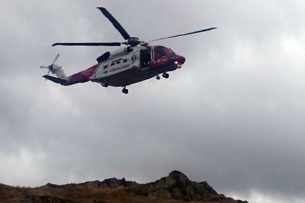 The Coastguard helicopter approaches to transfer the injured man. Photo: Keswick MRT