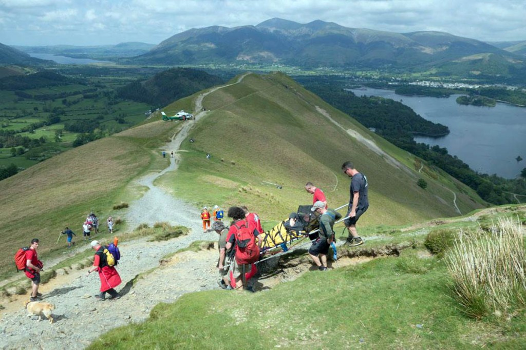 Team members stretcher the injured walker down to the helicopter. Photo: Stuart Holmes/Keswick MRT