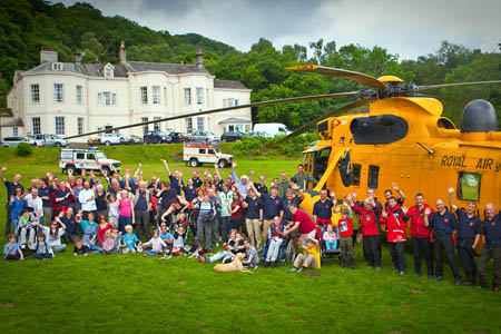 Children from the charities join mountain rescuers and the RAF Sea King crew