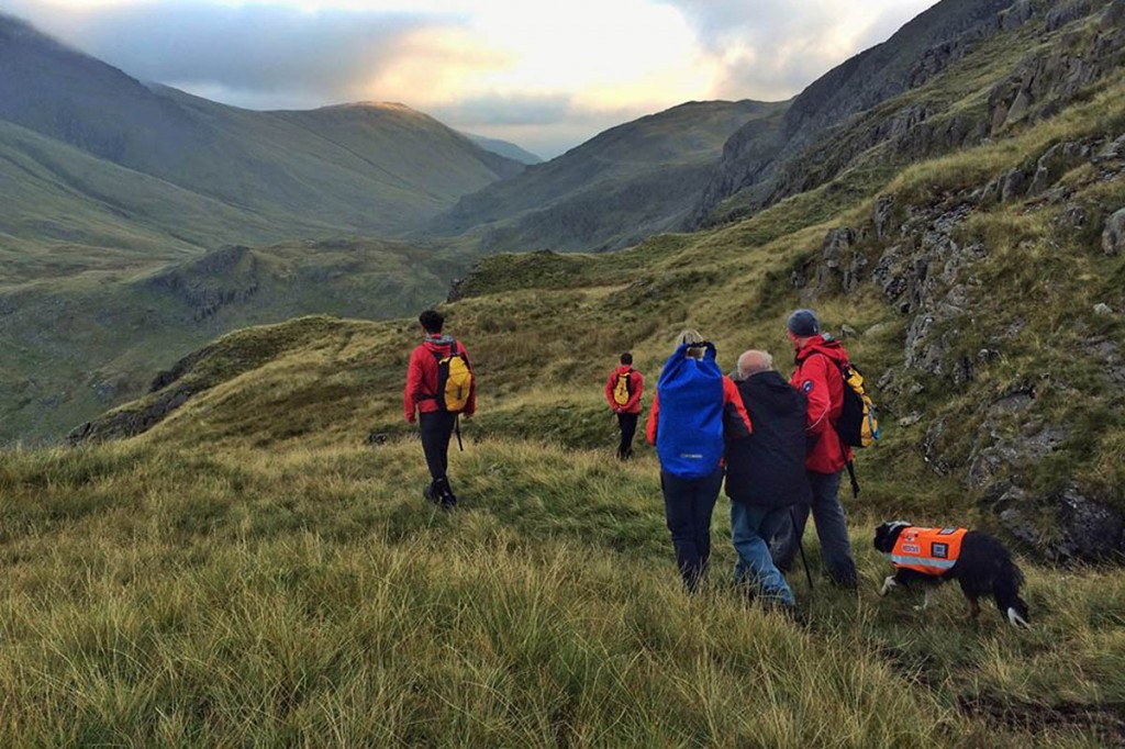 Keswick team members help the walkers to safety from Sty Head. Photo: Keswick MRT