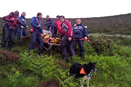 Keswick and Cockermouth Mountain Rescue Teams carry the fellrunner down from Doddick Fell. Photo: Keswick MRT