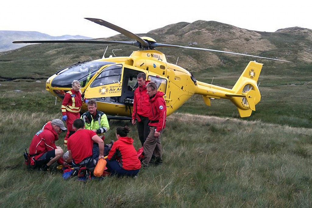 Rescuers and the air ambulance crew at the scene near Greenup Edge. Photo: Keswick MRT